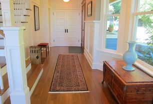 Craftsman Entryway with flush light, specialty door, High ceiling, Hardwood floors
