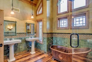Country Master Bathroom with specialty window, High ceiling, Casement, Hardwood floors, Pendant light, Wall sconce