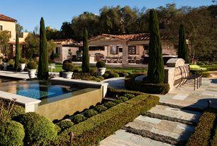 Mediterranean Patio with exterior stone floors, Outdoor kitchen, Pathway, Gazebo