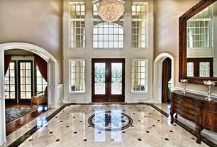 Traditional Entryway with Wainscotting, High ceiling, simple marble floors, specialty window, Paint, Chandelier, French doors