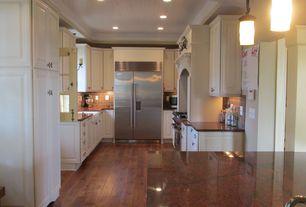 Traditional Kitchen with Custom hood, Stone Tile, double oven range, Farmhouse sink, Limestone Tile, Crown molding, U-shaped