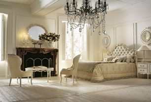 Traditional Master Bedroom with Hardwood floors, Casement, Exposed beam, Chandelier, metal fireplace, Fireplace