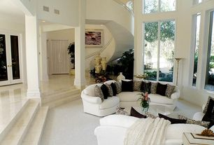 Traditional Living Room with Masonite Cyma Wood Door, Sunken living room, Carpet, Columns, High ceiling