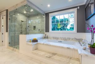 Traditional Master Bathroom with Standard height, Master bathroom, stone tile floors, frameless showerdoor, Crown molding