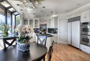 Traditional Kitchen with double wall oven, electric cooktop, Multiple Sinks, Breakfast nook, specialty door, Simple Granite