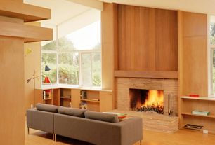 Contemporary Living Room with Cathedral ceiling, Built-in bookshelf, Concrete floors