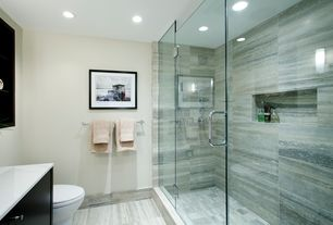 Contemporary 3/4 Bathroom with Wall sconce, European Cabinets, Pental Times in Grey, frameless showerdoor, Corian counters