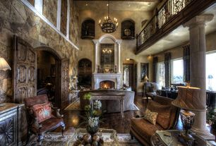 Traditional Living Room with Exposed beam, Fireplace, Chandelier, Hardwood floors, can lights, Columns, Cathedral ceiling