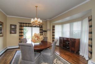 Traditional Dining Room with Standard height, Hardwood floors, double-hung window, Crown molding, sliding glass door