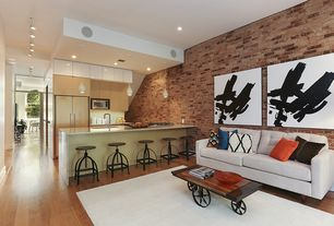 Rustic Living Room with interior brick, Hardwood floors, Butler Metalworks Revolving Bar Stool