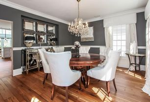 Traditional Dining Room with Hardwood floors, Chair rail, Crown molding, Chandelier