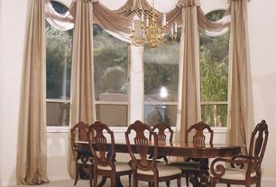 Traditional Dining Room with specialty window, Arched window, Concrete floors, Chandelier, High ceiling
