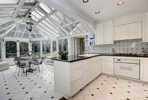 Traditional Kitchen with Pendant light, Flat panel cabinets, Flush, mexican tile backsplash, French doors, Custom hood