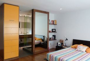 Contemporary Master Bedroom with Hardwood floors