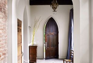 Eclectic Entryway with Pointed arches, Leather zebra cowhide rug, Arched doorway, Chandelier, Hardwood floors, specialty door