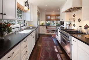 Traditional Kitchen with Herringbone Tile, dishwasher, Inset cabinets, Standard height, full backsplash, Custom hood