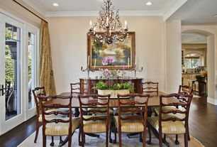 Traditional Dining Room with Wildon home penderbrook sideboard, Chandelier, French doors, Crown molding, Hardwood floors