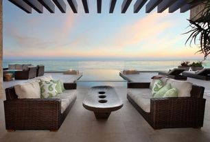Contemporary Patio with exterior tile floors, Trellis, Ocean view, Outdoor wicker furniture