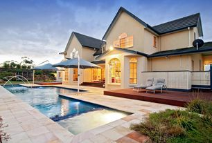 Modern Swimming Pool with Fountain, Arched window, Pool with hot tub, French doors, exterior stone floors, Casement, Pathway