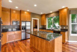 Traditional Kitchen with Simple Granite, French doors, Flush, U-shaped, European Cabinets, Hardwood floors, Kitchen island