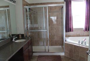 Traditional Master Bathroom with stone tile floors, framed showerdoor, Oregon Tile and Marble Breccia Damascatta Marble Tile