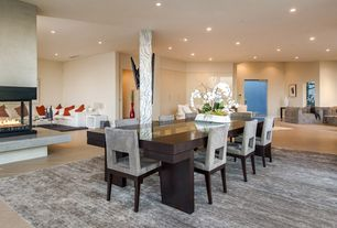 Contemporary Dining Room with metal fireplace, Columns, Cement fireplace, sandstone floors