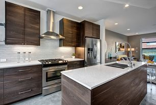 Contemporary Kitchen with Simple granite counters, Multiple Sinks, Wall Hood, Ceramic Tile, Multiple Refrigerators, gas range