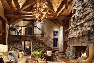 Rustic Living Room with Dionna greek key rug, Pendant light, Hardwood floors, Loft, Log beams, Banker wire wire mesh railing