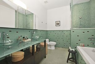 Contemporary Master Bathroom with Wall Tiles, Standard height, drop in bathtub, Glass counters, large ceramic tile floors