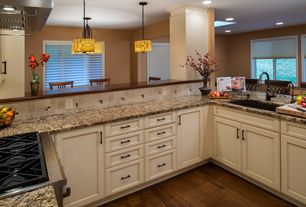 Traditional Kitchen with Breakfast bar, Simple granite counters, Standard height, Casement, can lights, Flush, gas range