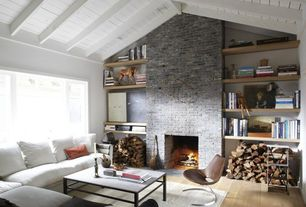 Contemporary Living Room with Built-in bookshelf, High ceiling, Fireplace, stone fireplace, Paint, Hardwood floors, Casement