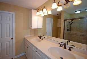 Traditional 3/4 Bathroom with Flush, limestone tile floors, Kohler devonshire widespread bathroom faucet with lever handles