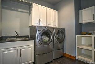 Traditional Laundry Room with Standard height, laundry sink, stone tile floors, Built-in bookshelf, soapstone tile floors