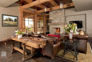 Eclectic Living Room with stone fireplace, Concrete floors, Pendant light, Exposed beam, High ceiling, Columns