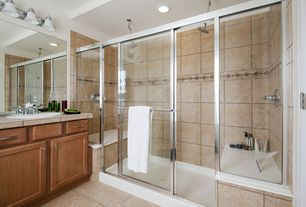 Craftsman Master Bathroom with framed showerdoor, Flat panel cabinets, stone tile floors, Limestone tile counters, can lights
