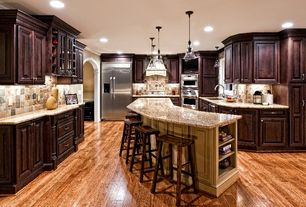 Traditional Kitchen with Undermount sink, dishwasher, Stone Tile, Breakfast bar, Built In Refrigerator, can lights, Casement