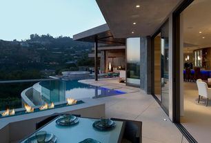 Modern Patio with Deck Railing, exterior tile floors, Fire pit, picture window, sliding glass door, Pathway