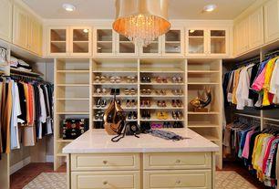 Traditional Closet with Standard height, can lights, Safavieh diamond filigree rug, Built-in bookshelf, Hardwood floors