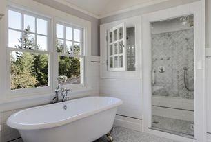 Traditional Master Bathroom with frameless showerdoor, Crown molding, Steam showerhead, ceramic tile floors, Clawfoot