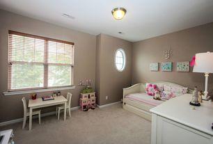 Traditional Kids Bedroom with Built-in bookshelf, Carpet, flush light