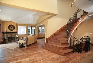 Mediterranean Staircase with Hardwood floors, Wall sconce, High ceiling