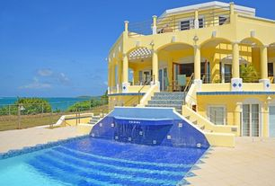 Mediterranean Swimming Pool with French doors, exterior stone floors, Fence