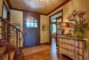 Traditional Entryway with Stained glass, Crown molding, Glass panel door, Ornate railing, Ceiling molding, Entry rug