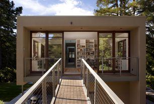 Contemporary Exterior of Home with Open concept, Bridge entry, Wood bridge, Natural light, Wood casement, Built-in bookshelf