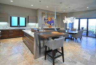 Contemporary Kitchen with Kitchen island, slate tile floors, French doors, Corian counters, L-shaped, Breakfast bar