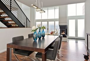 Contemporary Dining Room with Hardwood floors, High ceiling, Pendant light, French doors