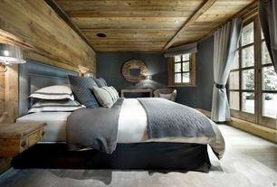 Rustic Master Bathroom with Upholstered headboard, Wall sconce, Exposed wood wall, Safavieh jeweled chain natural mirror