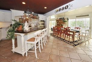 Country Great Room with Mural, Concrete tile , Built-in bookshelf, Columns, Chandelier, Arched window, Crown molding