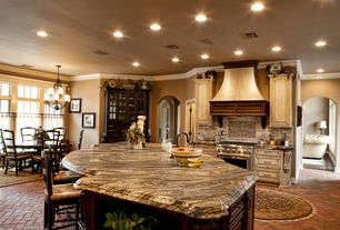 Country Kitchen with Custom hood, Chandelier, Ballard designs lemans counter stool, Complex granite counters, L-shaped