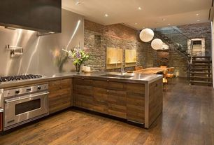 Contemporary Kitchen with Wall Hood, Pendant light, full backsplash, electric cooktop, can lights, Stainless Steel, wall oven